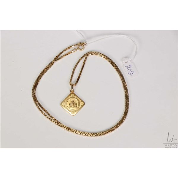 """18kt yellow gold box chain gold stamped marked 750, 24.5"""" in length and 18kt yellow gold """"Ava Maria"""""""