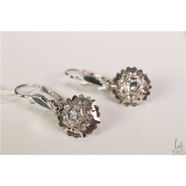 18kt white gold lever back earrings set with white diamond like gemstone, gold stamp marked 750