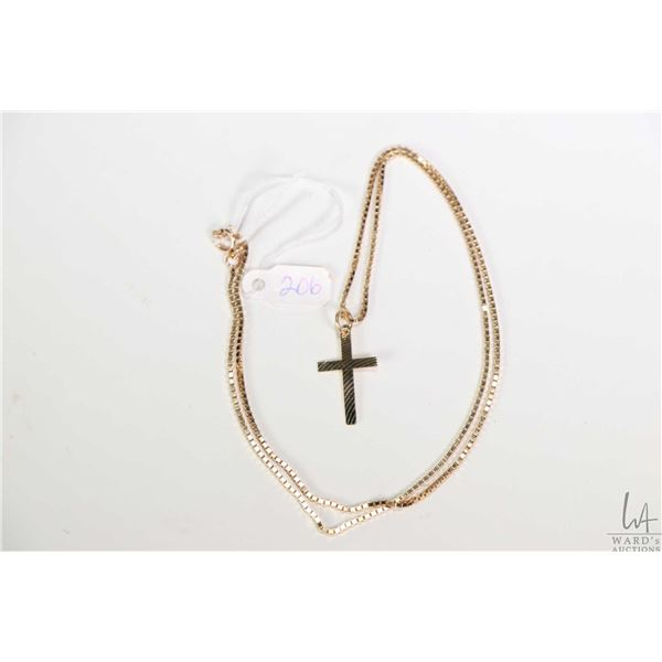 """10kt yellow gold box chain 20"""" in length, with gold cross pendant"""