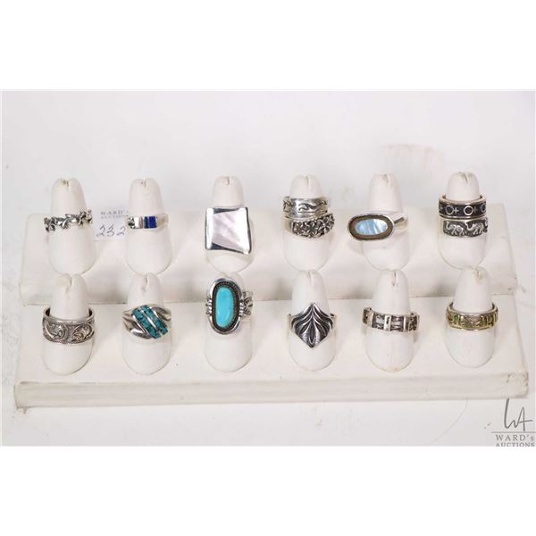 Large selection of sterling and silver rings including turquoise, mother-of-pearl etc.
