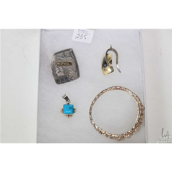 Selection of silver jewellery including Haida pendant, two pendants including one set with turquoise