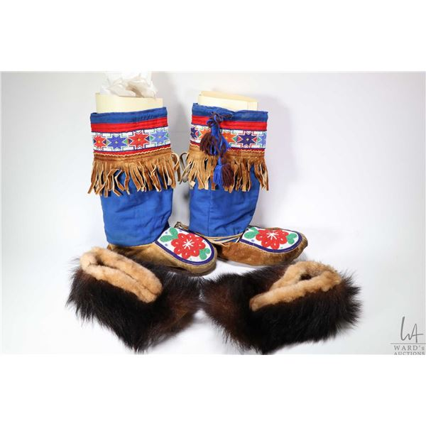 """Pair of beaded leather and cotton mukluks, foot length 10""""  and a pair of possible bear skin slipper"""