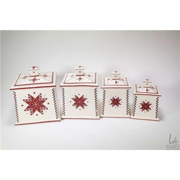 Four piece glazed ceramic Ukranian designed canister set, a framed needlework cross picture and a vi