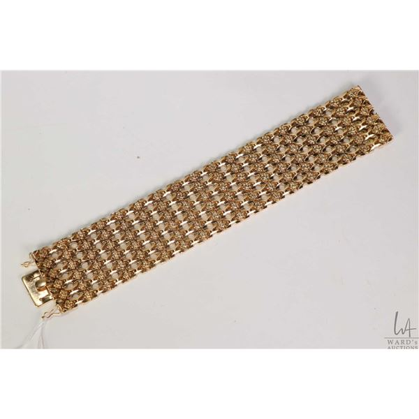"""18kt yellow thick yellow gold ladies bracelet, stamped with gold marking 750, 7.5"""" in length and 1 3"""