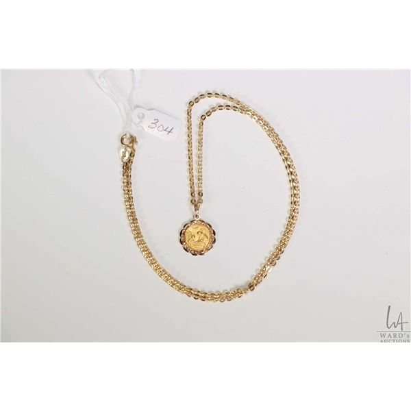 """18kt yellow gold neck chain gold stamped marked 750, 20"""" in length and a """"Recordo Del Battesimo"""" 18k"""