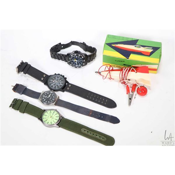 Four gent's wrist watches including Pulsar 100 meter watch, a Lan Du and an Uzi 200 meter, all in no
