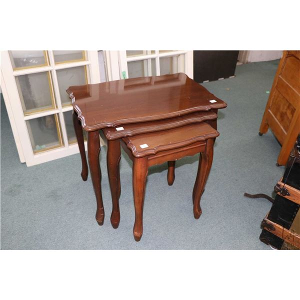 Set of three Heirloom brand mahogany nesting tables