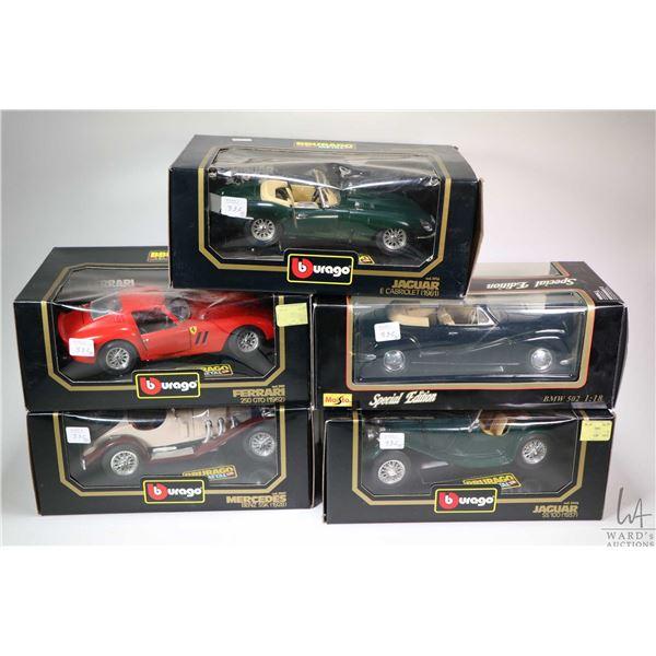 Five boxed die cast 1:18 scale cars including a 1928 Mercedes SSK, a 1962 Ferrari 250 GTO, a 1961 Ja