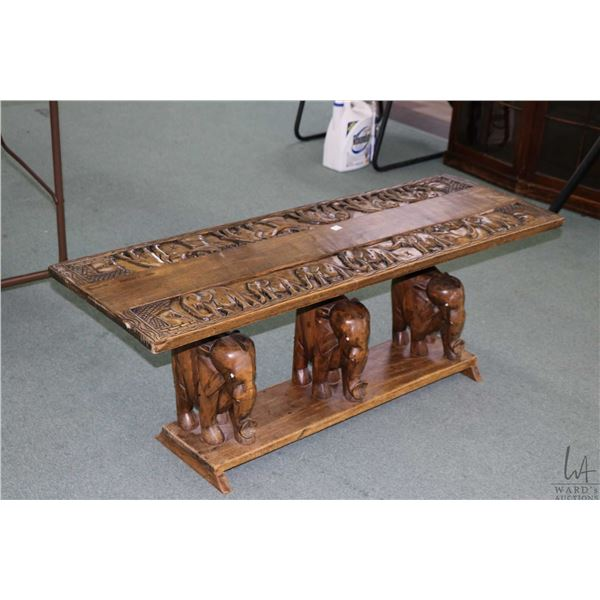 Hand carved elephant motif coffee table with triple pedestal 3 dimensional elephants base and carved