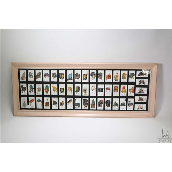 """Framed Players Cigarette card collection including 50 framed individual cards from the """"Military Hea"""
