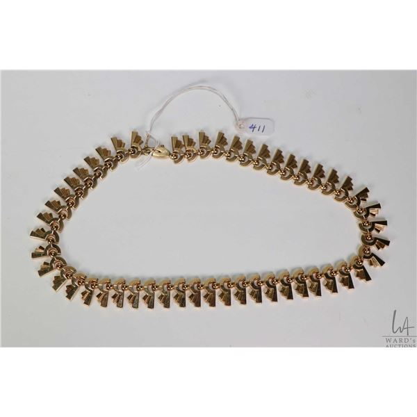 """18kt yellow gold articulated necklaces with gold marking 750, 16.5"""" in length. Retail replacement va"""
