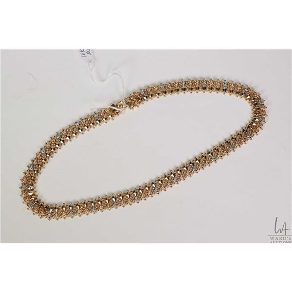 """18kt yellow and white gold necklace stamped with gold marking 750, 17.5"""" in length. Retail replaceme"""