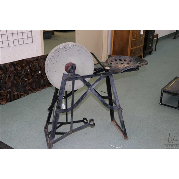 """Foot pedal operated 17"""" diameter grinding wheel with stand and operator seat. Not Available For Ship"""