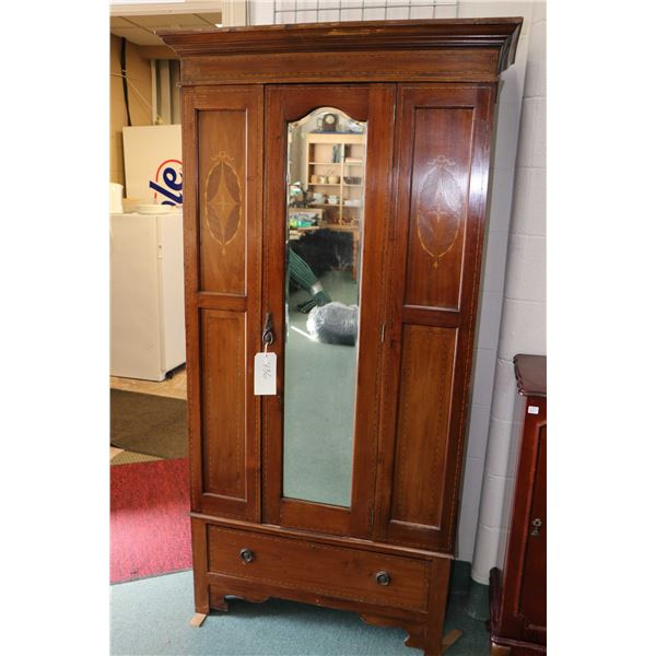Antique English Sheraton style single door wardrobe with inlaid panels and ribbons, bevelled mirror