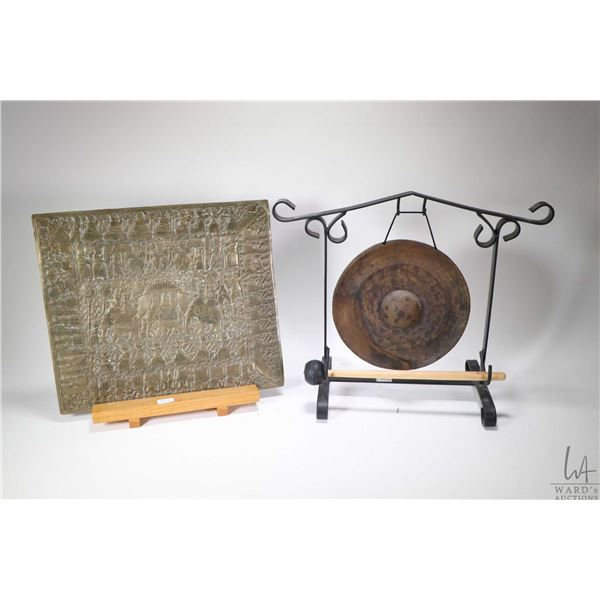 Table top gong with frame and mallet, a brass bas relief plaque 13 3/4  X 12  with wooden plinth