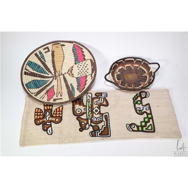 """Two small colourful woven baskets and a needlework wall hanging approximately 20"""" X 7"""""""