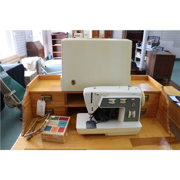 Singer Stylist portable electric sewing machine with original manual, carry cover etc. working at ti