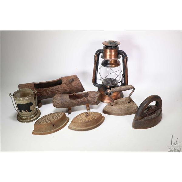 Selection of collectibles including four sadirons, weld art log motif ashtray and small planter etc.