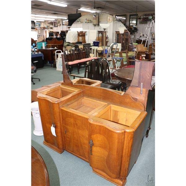 Antique quarter cut oak Art Deco bedroom chest with matched grain panels and round mirror, note miss