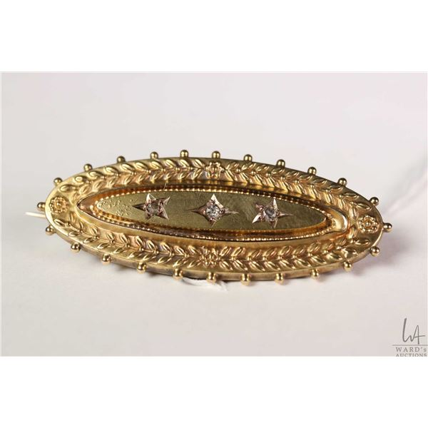Antique English 15ct yellow gold mourning brooch set with three small accent diamonds and clear wind