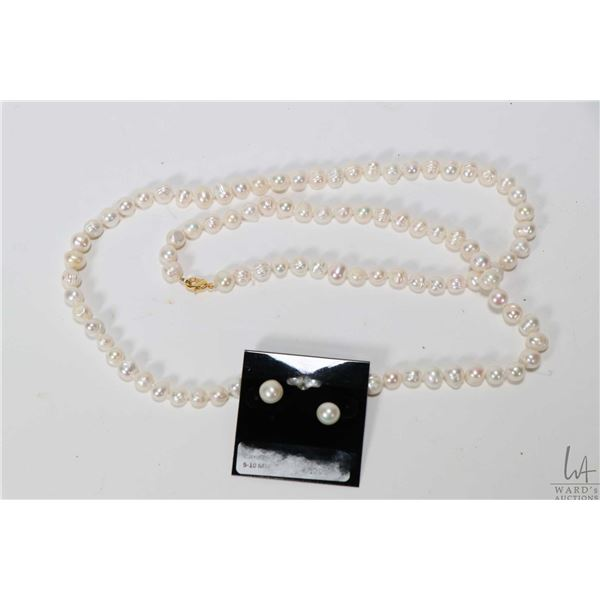 """Strand of individually knotted fresh water pearls 32"""" in length with gold tone clasp plus a pair of"""