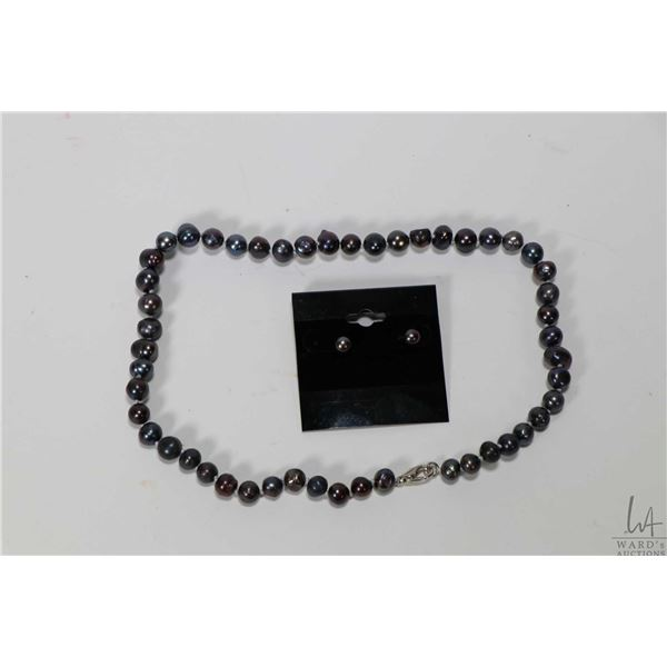 """Strand of individually knotted blackish purple fresh water pearl necklace 16"""" in length with silver"""