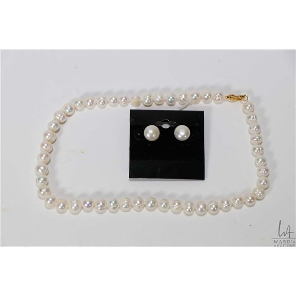 """Strand of individually knotted 16"""" fresh water pearl necklace with gold tone clasp and a pair of 10-"""
