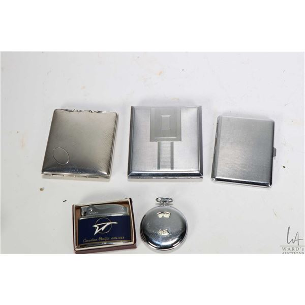 Two small trays of collectibles including three cigarette cases, a Canadian Pacific Airlines cigaret