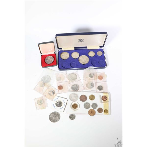Selection of Canadian coins including 1965 silver dollar, Centennial coins including one $1 coin, tw