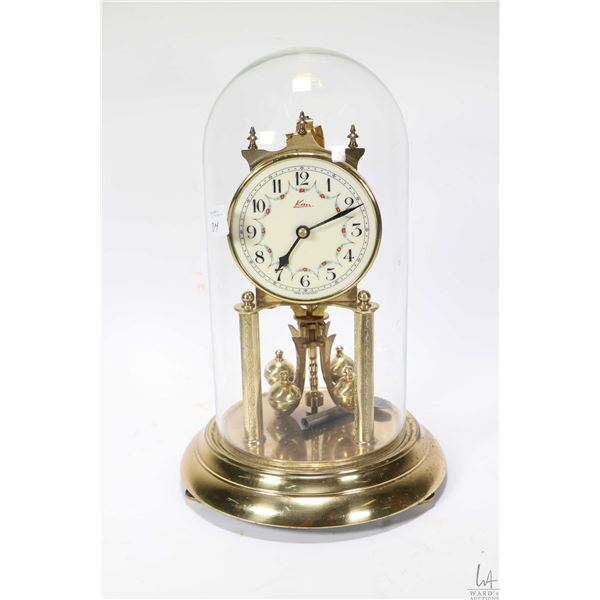 Dome top Kern anniversary clock with glass dome, working at time of cataloguing