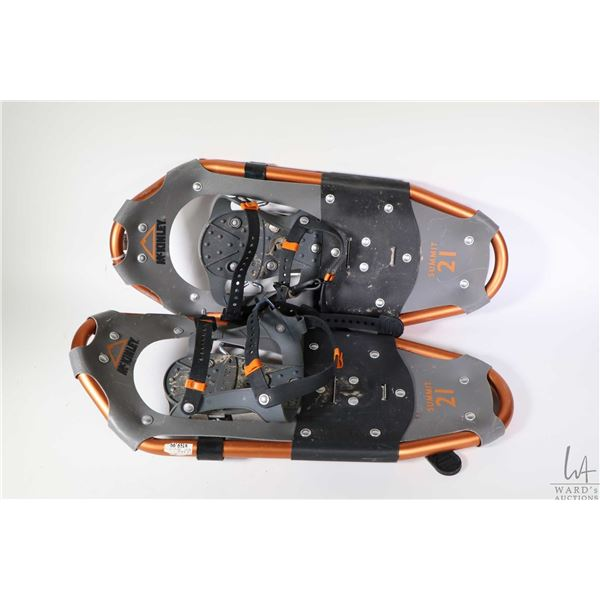 Two pairs of aluminium framed snow shoes including McKinley Summit 21 and a Powderidge 25 Crest