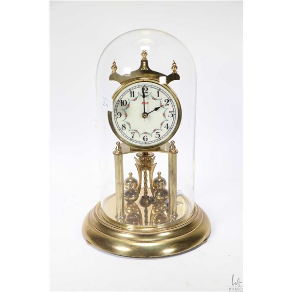 Dome to Kundo anniversary clock with glass dome, working at time of cataloguing