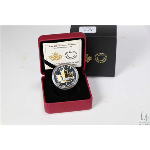 Royal Canadian Mint 2019 Timeless Icons 99.99% fine silver $25 coin with loon and gold plated maple