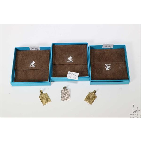 Three Birks British Columbia Philatelic Society stamp motif pendants including one silver metal and
