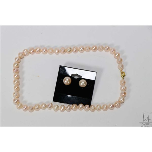 """Strand of individually knotted peach coloured fresh water pearl necklace with gold tone clasp 16"""" in"""