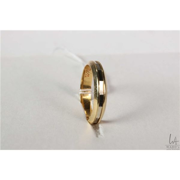 18kt yellow and white gold band with European gold marking 750, size 7.25