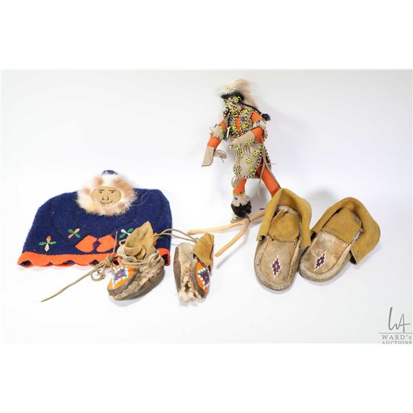 Selection of First Nations handicrafts including two pair of beaded children's moccasins, note in di