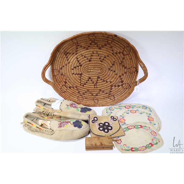 Selection of First Nations/ Inuit handicrafts including a pair of beaded moccasins, three needlework