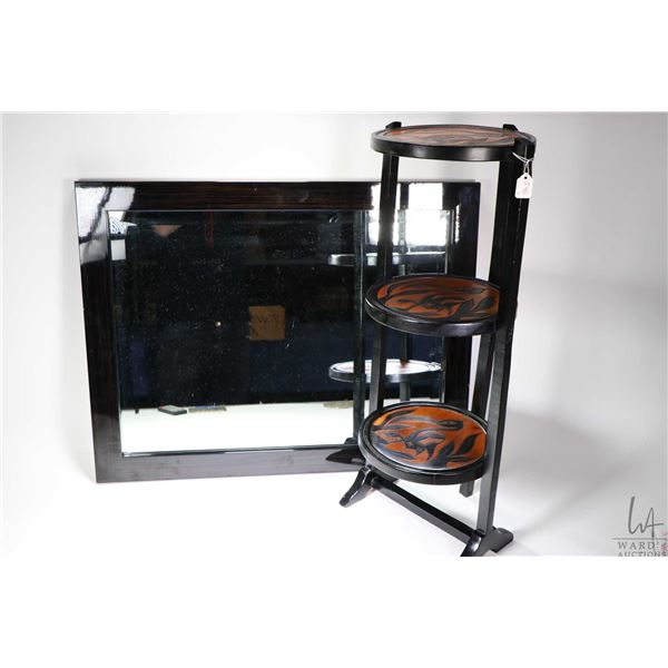 Three tier folding butler table with carved bird motif tops and a laminated wooden bevelled wall mir