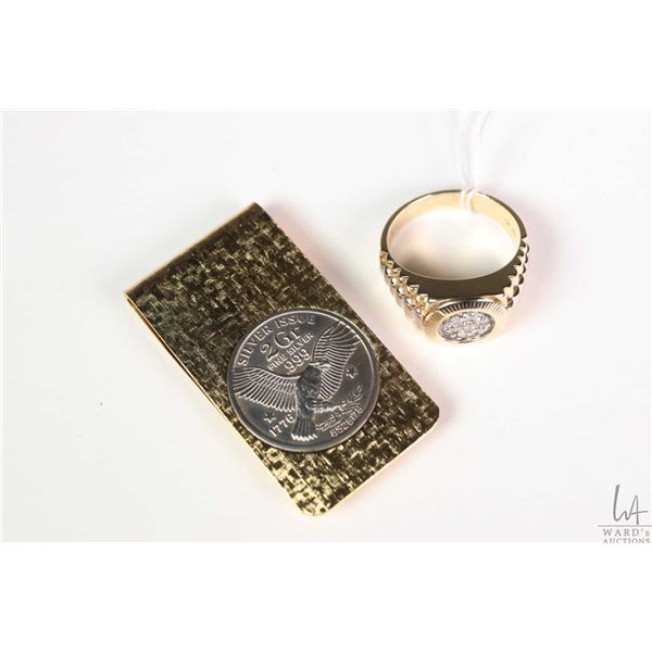 Gent's 10kt yellow and white gold ring set with seven white diamonds plus a coin style money clip
