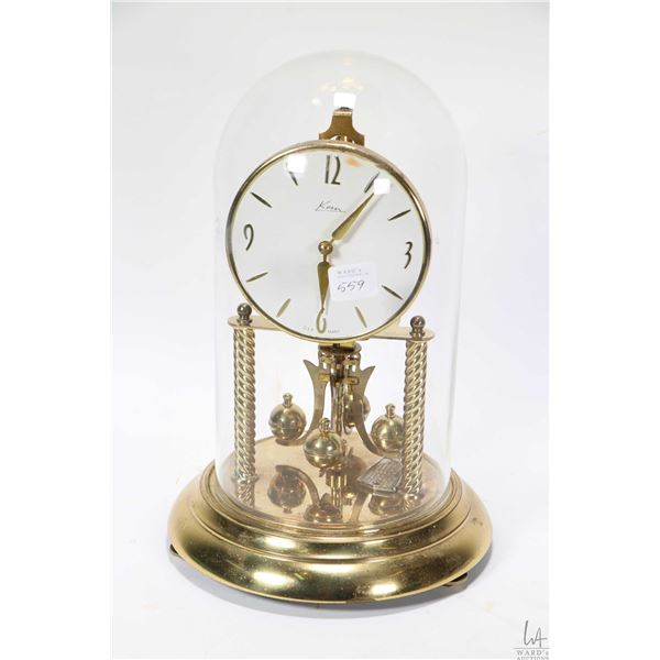 Dome top Kern anniversary clock with glass dome, working at time of cataloguing. Not Available For S