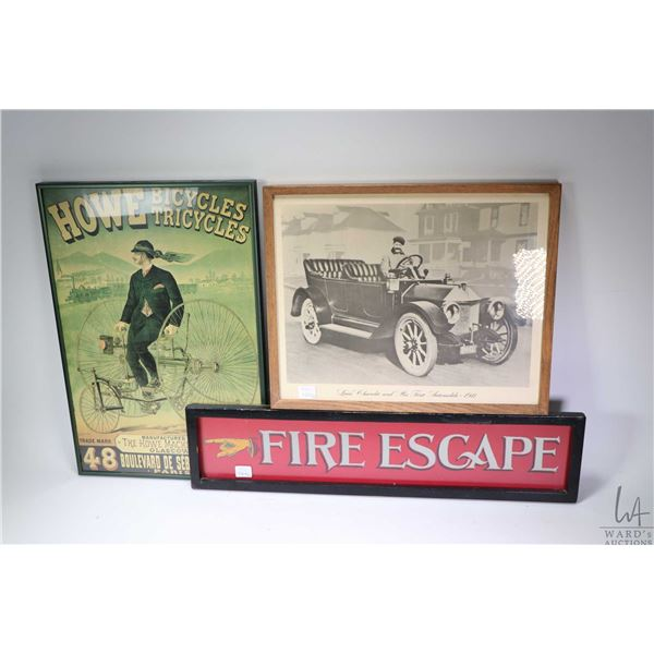 Framed Fire Escape sign, picture of Louis Chevrolet and his first automobile, reproduction of a Howe