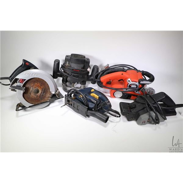Five assorted electric hand tools including a Skil 1840 router, a Skil saw model 5150, a Mastercraft
