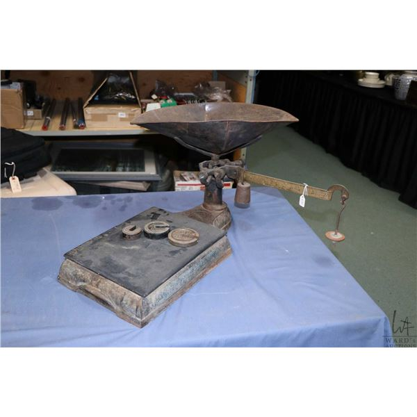 Vintage hardware store balance scale with three weights and tray. Not Available For Shipping. Local