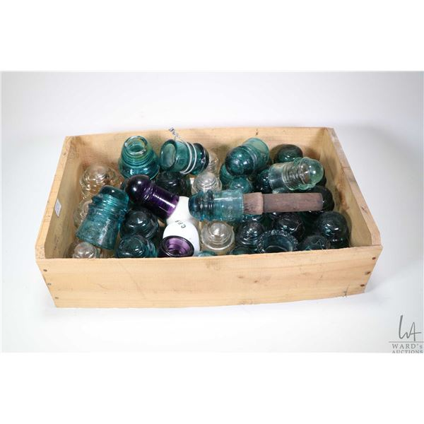 Wooden crate and contents including a large selection of coloured glass and porcelain insulators, ap