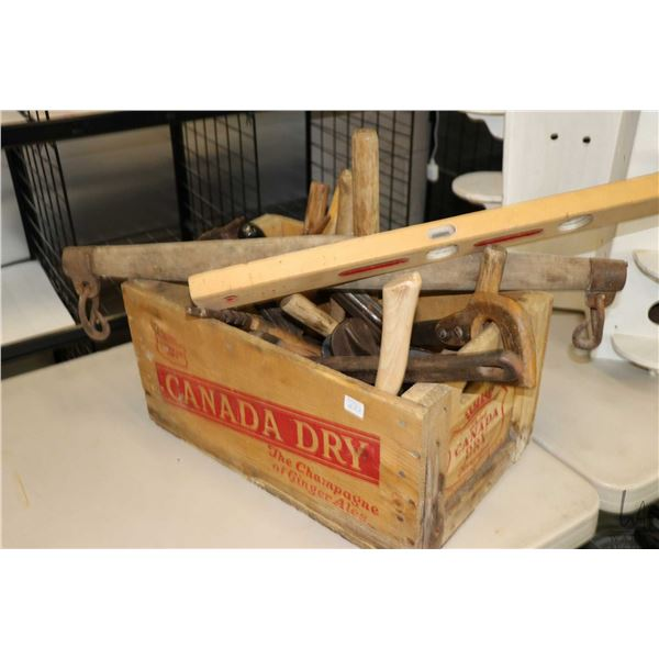 Canada Dry wooden crate with a selection of hand tools including shoe lasts and stands, hand saws, s