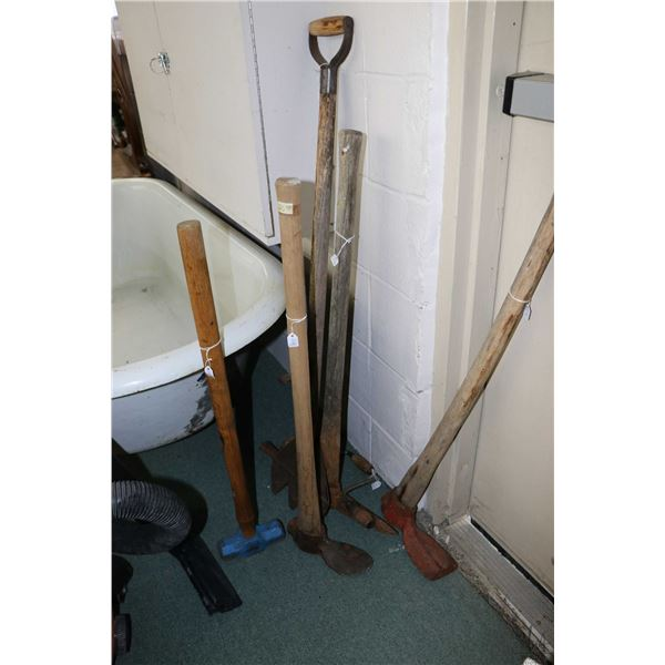 Selection of vintage hand tools including pick axes, a cutting bar, hand auger, sledge hammer and tw