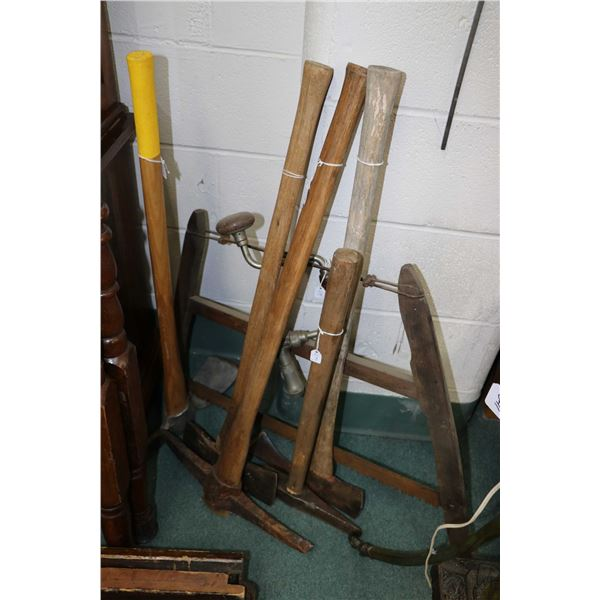 Selection of vintage tools including pick axe, hoes, double headed axe, bow saw and an auger. Not Av
