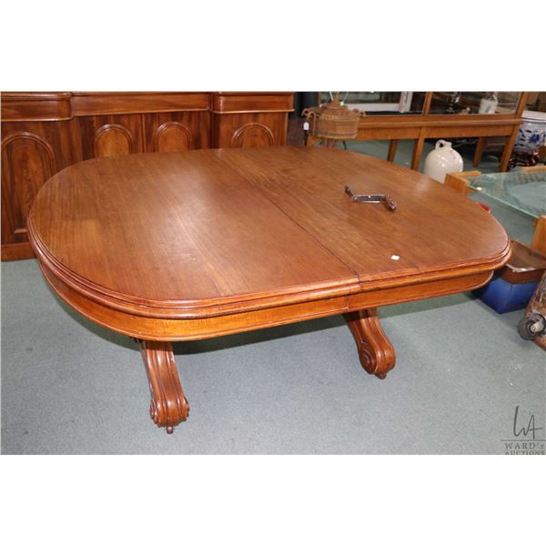 """Antique Victorian mahogany crank table 55"""" X 65"""" table top and four 20"""" insert leaves with scroll su"""