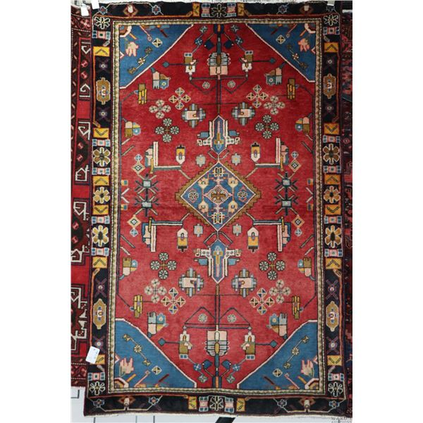 100% Iranian Mah Abad area carpet with center medallion, red background and highlights of blues, cre